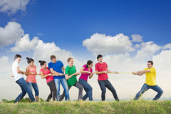 Group of young people pulling a rope. In nature Royalty Free Stock Image