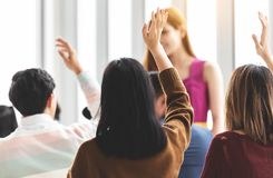 Group of young people Raising Hands Up. royalty free stock images