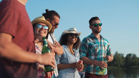Group of young people relaxing with beers and drinks royalty free stock images