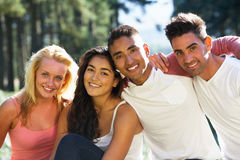 Group Of Young People Relaxing In Countryside Royalty Free Stock Photos