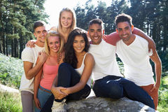 Group Of Young People Relaxing In Countryside Stock Photography