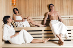 Group of young people relaxing in a sauna Stock Photos
