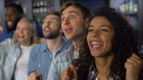 Group of young people rooting for team, national league support, event audience. Stock footage stock footage
