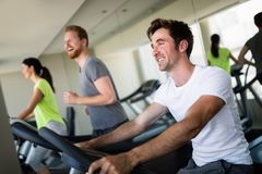 Group of young people running on treadmills in modern sport gym royalty free stock photo