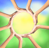 Group of young people's hands over bright nature background Stock Photography