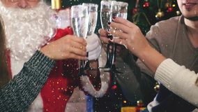 Group of young people with Santa celebrating New Year 2017 stock footage