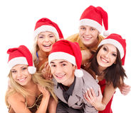 Group young people in santa hat . Royalty Free Stock Image