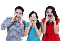 Group of young people shouting Royalty Free Stock Photo