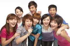 A group of young people singing Stock Photos