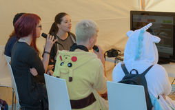 Group of young people singing at karaoke tent  at Animefest Stock Photography