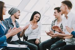 Group of young people sit in circle and support royalty free stock photography