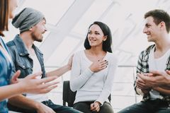 Group of young people sit in circle and support stock photos