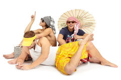 Group of young people sitting. Beach theme Royalty Free Stock Photo