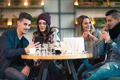 Group of young people sitting in a coffee shop. Having fun Stock Photos