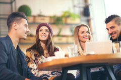 Group of young people sitting in a coffee shop. Having fun Royalty Free Stock Photo