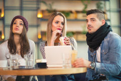 Group of young people sitting in a coffee shop. Having fun Stock Photography