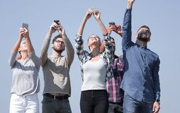 Group of young people with smartphones royalty free stock images