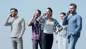 Group of young people with smartphones Stock Photo