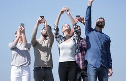 Group of young people with smartphones royalty free stock photo