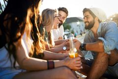 Group of young people smiling, talking and having fun together stock image