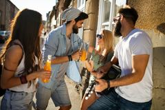 Group of young people smiling, talking and having fun together royalty free stock photo