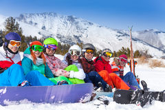 Group of young people with snowboards and goggles Royalty Free Stock Photo