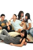 Group of young people on sofa. Group of young people on relaxing sofa Stock Images