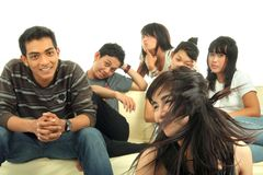 Group of young people on sofa stock image