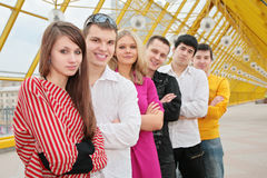 Group of young people stand on footbridge Stock Images