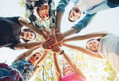Group of young people standing in a circle, outdoors Stock Image