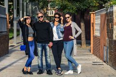 Group of young people standing on the ghetto street. royalty free stock image