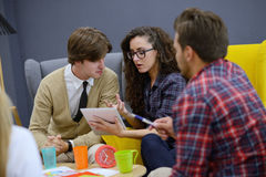 Group of young people, Startup entrepreneurs working on their venture in coworking space Royalty Free Stock Images