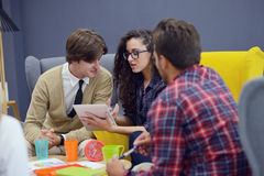Group of young people, Startup entrepreneurs working on their venture in coworking space Royalty Free Stock Photography