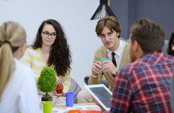 Group of young people, Startup entrepreneurs working on their venture in coworking space Stock Photos