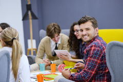 Group of young people, Startup entrepreneurs working on their venture in coworking space Stock Image