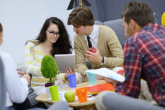 Group of young people, Startup entrepreneurs working on their venture in coworking space Royalty Free Stock Photo