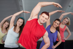 A group of young people stretching Royalty Free Stock Photo