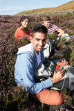 Group Of Young People Taking Break On Hike Stock Photography