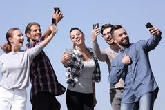 Group of young people taking a selfie. stock images