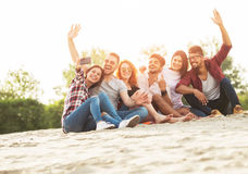 Group of young people taking a selfie outdoors on the beach. Having fun Royalty Free Stock Photo