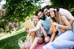 Group of young people taking a selfie outdoors, having fun stock photography