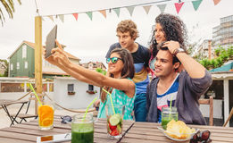 Group of young people taking a selfie with tablet Royalty Free Stock Image