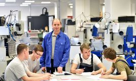Group of young people in technical vocational training with teac. Her Royalty Free Stock Image