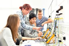 Group of young people in technical vocational training with teacher stock photo