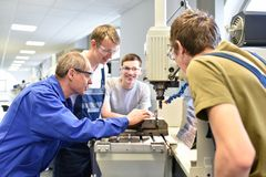 Group of young people in technical vocational training with teacher royalty free stock photography