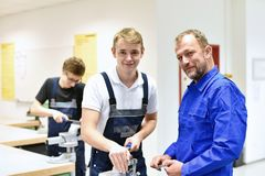 Group of young people in technical vocational training with teacher royalty free stock photo