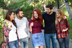 Group of young people together outdoors in urban background Royalty Free Stock Images