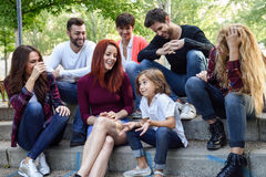 Group of young people together outdoors in urban background stock photos