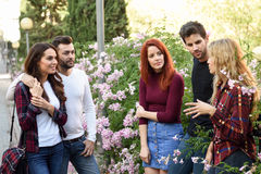 Group of young people together outdoors in urban background Stock Images