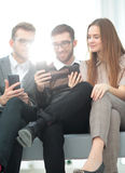 Group of young people use their phones Royalty Free Stock Image
